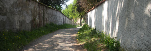 Through the alley between two estates on the trail from Lyon to Le Puy-en-Velay, France 2009
